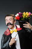 Funny magician with wand Royalty Free Stock Photography