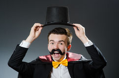 Funny magician with wand Royalty Free Stock Photo
