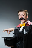 Funny magician with wand Royalty Free Stock Image