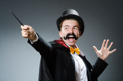 Funny magician with wand Royalty Free Stock Images