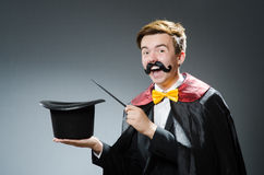 Funny magician with wand Stock Photography