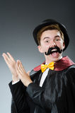 Funny magician with wand Royalty Free Stock Photos