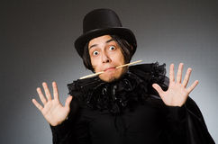 The funny magician wearing cylinder hat Royalty Free Stock Images