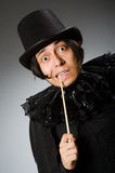 The funny magician wearing cylinder hat Stock Image