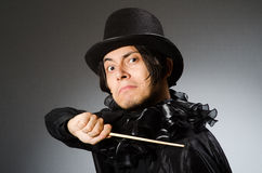 The funny magician wearing cylinder hat Stock Photo