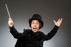 The funny magician wearing cylinder hat Stock Images