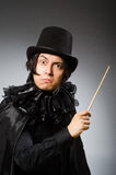 The funny magician wearing cylinder hat Stock Photos