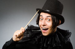The funny magician wearing cylinder hat Stock Photography