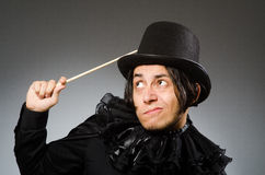 Funny magician wearing cylinder hat Stock Image