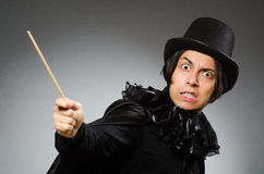 The funny magician wearing cylinder hat. Funny magician wearing cylinder hat Royalty Free Stock Photography