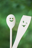 Funny making faces wooden spoons. Shallow dof Royalty Free Stock Images