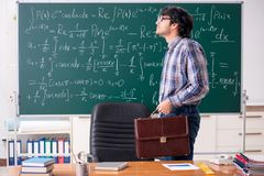 The funny male math teacher in the classroom. Funny male math teacher in the classroom royalty free stock image