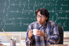 The funny male math teacher in the classroom. Funny male math teacher in the classroom royalty free stock photo