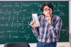 The funny male math teacher in the classroom. Funny male math teacher in the classroom royalty free stock photos