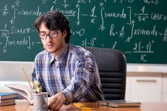 The funny male math teacher in the classroom. Funny male math teacher in the classroom stock photos