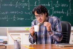 The funny male math teacher in the classroom. Funny male math teacher in the classroom royalty free stock photography