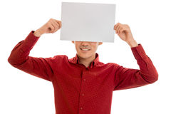 Funny male model in red shirt posing with empty placard isolated on white background Royalty Free Stock Image