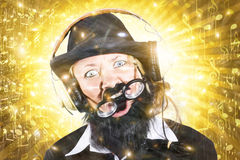 Funny male sound engineer. Mad about music Royalty Free Stock Image