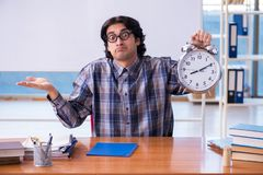 The funny male teacher in front of whiteboard. Funny male teacher in front of whiteboard stock photos
