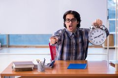 The funny male teacher in front of whiteboard. Funny male teacher in front of whiteboard stock photography