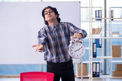 The funny male teacher in front of whiteboard. Funny male teacher in front of whiteboard royalty free stock image