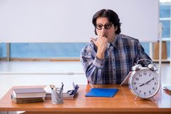 The funny male teacher in front of whiteboard. Funny male teacher in front of whiteboard stock image