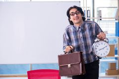 The funny male teacher in front of whiteboard. Funny male teacher in front of whiteboard royalty free stock photo