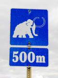 Funny mammoth symbol on road sign Royalty Free Stock Photography