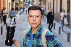 Funny man addicted to soda stock images