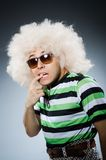 Funny man with afro hairstyle isolated on white Stock Photo