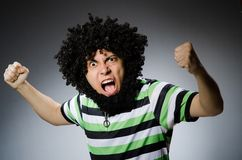 Funny man with afro hairstyle isolated on white Stock Photos