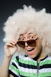 Funny man with afro hairstyle isolated on the Stock Photo