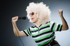 Funny man with afro hairstyle  on white Royalty Free Stock Image