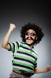 Funny man with afro hairstyle  on white Stock Photo