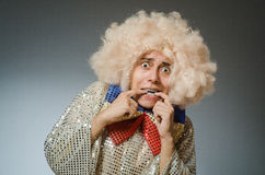 The funny man with afro wig Stock Image