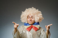 The funny man with afro wig Stock Photo
