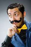 The funny man against dark background. Funny man against dark background Royalty Free Stock Images