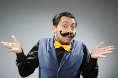 The funny man against dark background. Funny man against dark background Royalty Free Stock Photo