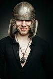 Funny man in ancient helmet Stock Photography