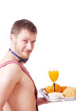 Funny man in an apron with breakfast Stock Photo