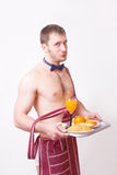 Funny man in an apron with breakfast Royalty Free Stock Image