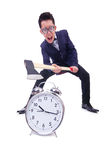 Funny man with axe and clock Stock Photography