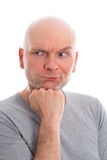 Funny man with bald head  is refacting Royalty Free Stock Image