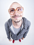Funny man with big glasses cross looking and smiling Stock Photo
