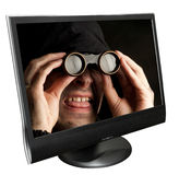 Funny man with binocular in a computer monitor Stock Image