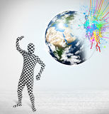 Funny man in body suit looking at colorful splatter earth Stock Images