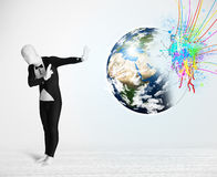 Funny man in body suit looking at colorful splatter earth. Funny man in body suit looking at colorful splatter 3d earth, Elements of this image furnished by NASA Stock Images