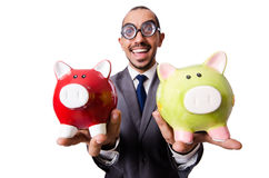 Funny man breaking his piggy bank Stock Image