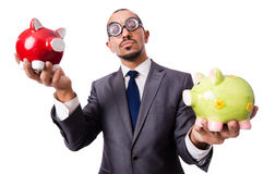 Funny man breaking his piggy bank Stock Photo