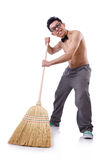Funny man with broom Royalty Free Stock Photography